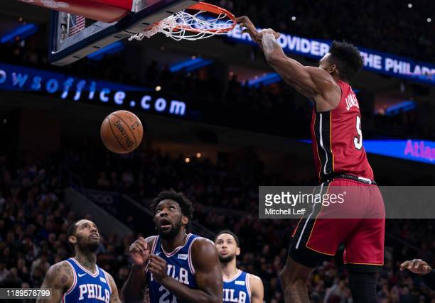 Derrick Jones Jr #5 of the Miami Heat dunks the ball past Mike Scott Joel Embiid and Ben Simmons of the Philadelphia 76ers in the third quarter at...