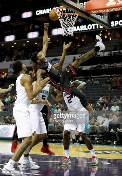 Derrick Jones Jr #5 of the Miami Heat goes after a loose ball against the Charlotte Hornets during their game at Spectrum Center on October 2 2018 in...