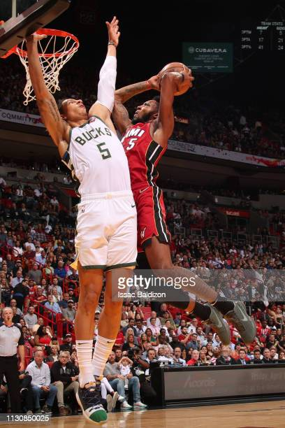 Derrick Jones Jr #5 of the Miami Heat goes to the basket against the Milwaukee Bucks on March 15 2019 at American Airlines Arena in Miami Florida...