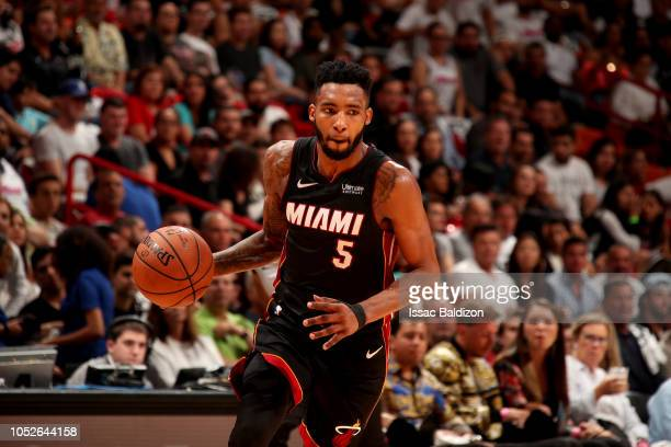 Derrick Jones Jr #5 of the Miami Heat handles the ball against the Charlotte Hornets on October 20 2018 at American Airlines Arena in Miami Florida...
