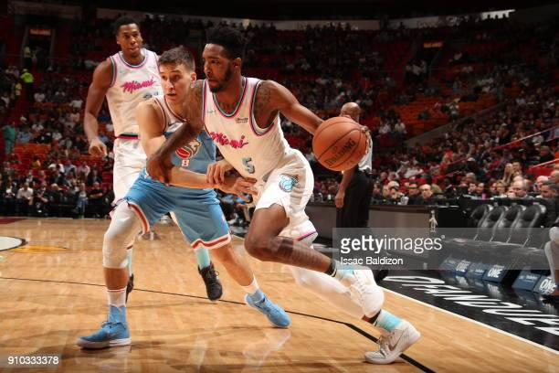 Derrick Jones Jr #5 of the Miami Heat handles the ball against the Sacramento Kings on January 25 2018 at AmericanAirlines Arena in Miami Florida...