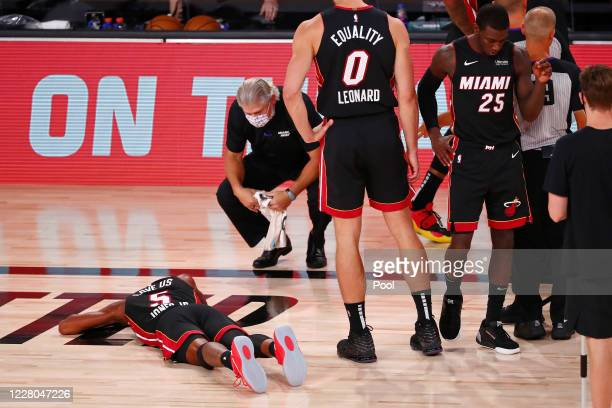 Derrick Jones Jr. #5 of the Miami Heat lays face down on the court after colliding with Goga Bitadze of the Indiana Pacers during the second half of...