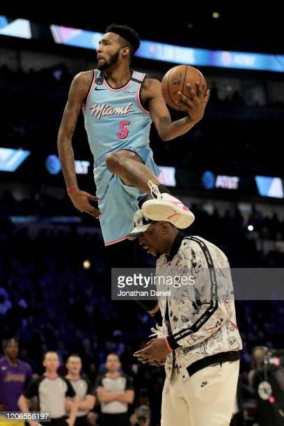 Derrick Jones Jr #5 of the Miami Heat leaps over Bam Adebayo of the Miami Heat in the 2020 NBA AllStar ATT Slam Dunk Contest during State Farm...