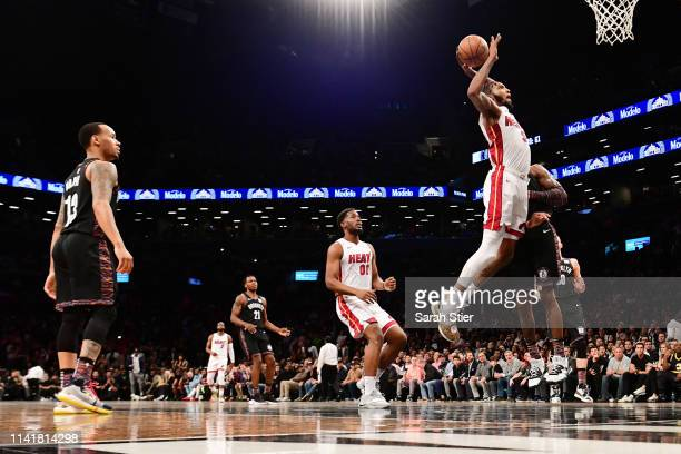 Derrick Jones Jr #5 of the Miami Heat makes a slam dunk during the second half of the game against the Brooklyn Nets at Barclays Center on April 10...