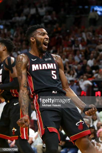 Derrick Jones Jr #5 of the Miami Heat reacts after a dunk against the Charlotte Hornets during the first half at American Airlines Arena on October...