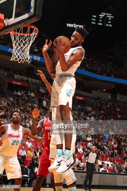 Derrick Jones Jr #5 of the Miami Heat rebounds the ball during the game against the Houston Rockets on February 7 2018 at American Airlines Arena in...