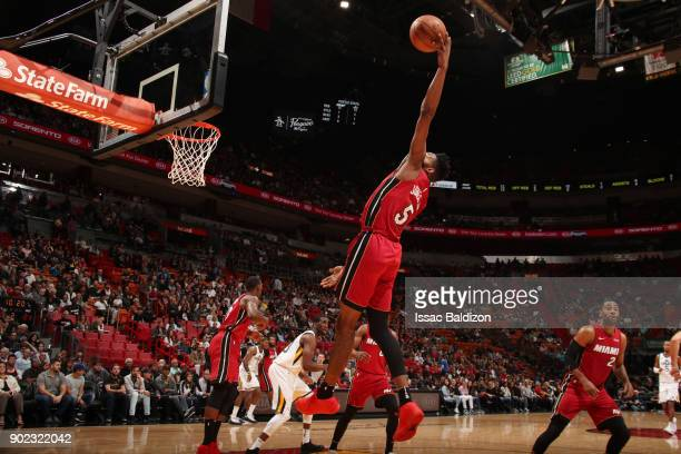 Derrick Jones Jr #5 of the Miami Heat recovers a rebound during the game against the Utah Jazz on January 7 2018 at American Airlines Arena in Miami...