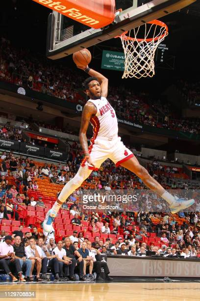 Derrick Jones Jr #5 of the Miami Heat slams a dunk during the game against the Toronto Raptors on March 10 2019 at American Airlines Arena in Miami...