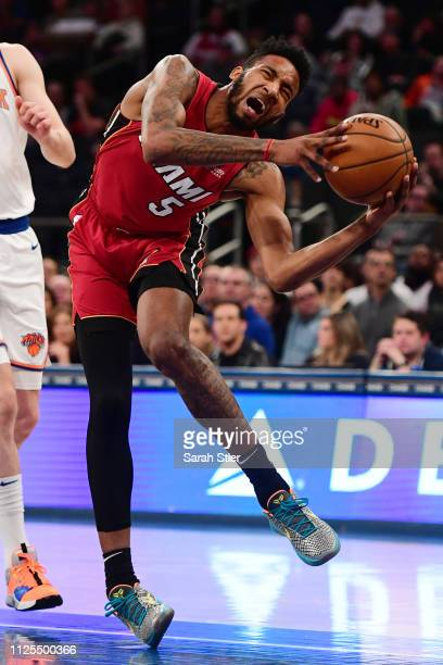 Derrick Jones Jr #5 of the Miami Heat suffers a knee injury during the second quarter of the game against the New York Knicks at Madison Square...