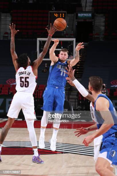 Derrick Jones Jr. #55 of the Portland Trail Blazers blocks the ball during the game against Luka Doncic of the Dallas Mavericks on March 19, 2021 at...