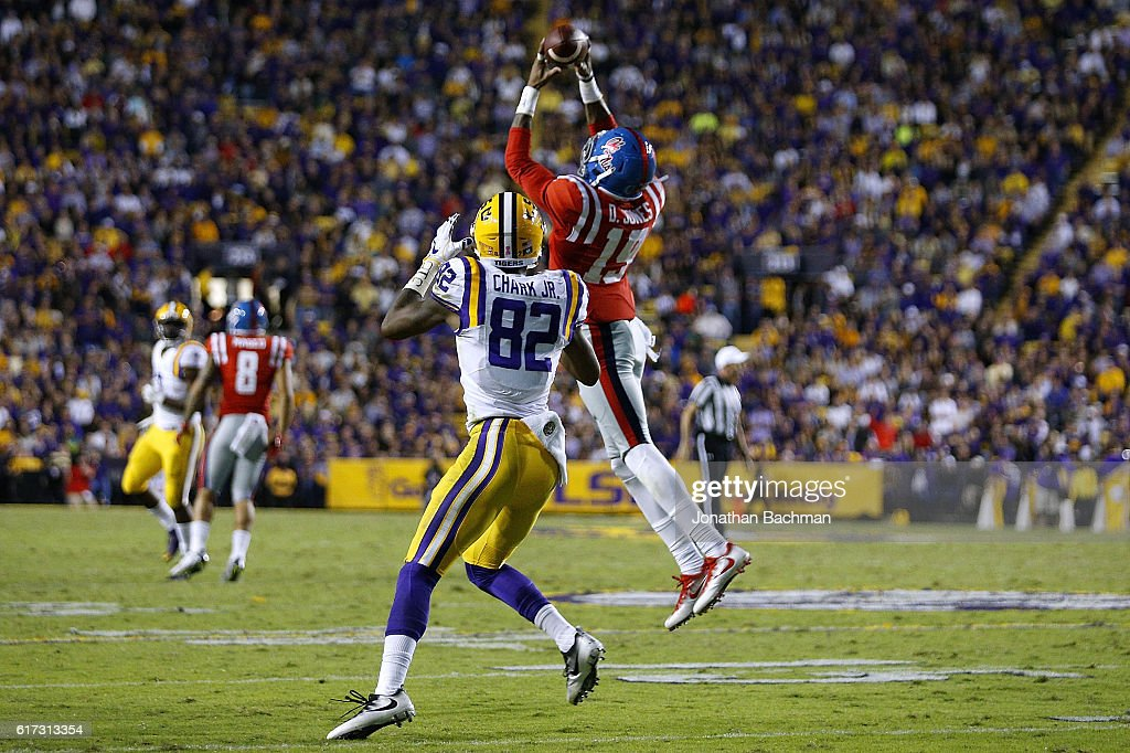 Derrick Jones #19 of the Mississippi Rebels intercepts the ball over D.J. Chark #82 of the LSU Tigers during the second half of a game at Tiger Stadium on October 22, 2016 in Baton Rouge, Louisiana.