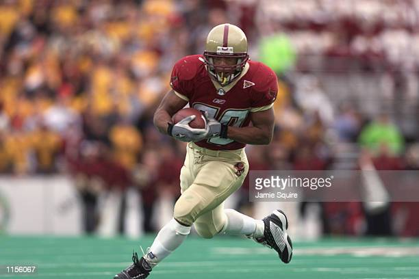 Derrick Knight of the Boston College Eagles runs with the ball against the Miami Hurricanes during the game on November 10 2001 at Alumni Field in...