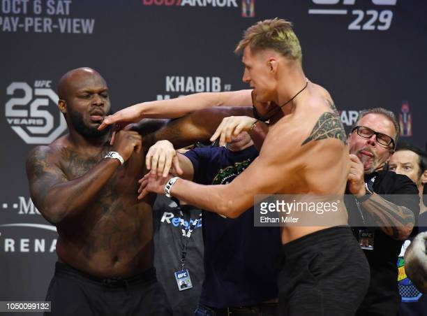 Derrick Lewis and Alexander Volkov get into a scuffle during a ceremonial weighin for UFC 229 at TMobile Arena on October 05 2018 in Las Vegas Nevada...