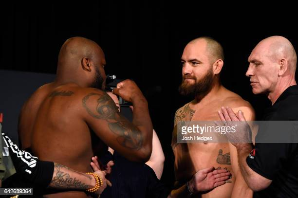 Derrick Lewis and Travis Browne face off during the UFC Fight Night weighin at the World Trade Convention Centre on February 18 2017 in Halifax Nova...