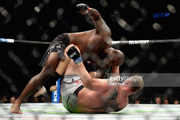 Derrick Lewis beats on Alexander Volkov of Russia to a knock out in their heavyweight bout during the UFC 229 event inside TMobile Arena on October 6...