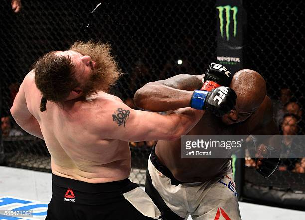 Derrick Lewis connects with a right hand against Roy Nelson in their heavyweight bout during the UFC Fight Night event inside the MGM Grand Garden...