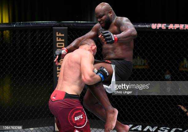 Derrick Lewis knees Aleksei Oleinik of Russia in their heavyweight fight during the UFC Fight Night event at UFC APEX on August 08, 2020 in Las...