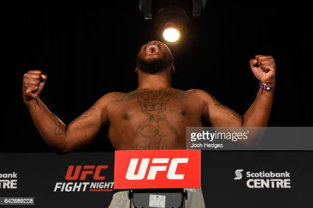 Derrick Lewis poses on the scale during the UFC Fight Night weighin at the World Trade Convention Centre on February 18 2017 in Halifax Nova Scotia...