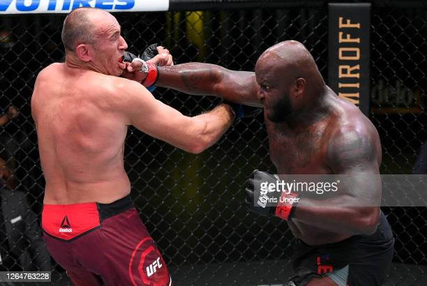 Derrick Lewis punches Aleksei Oleinik of Russia in their heavyweight fight during the UFC Fight Night event at UFC APEX on August 08, 2020 in Las...