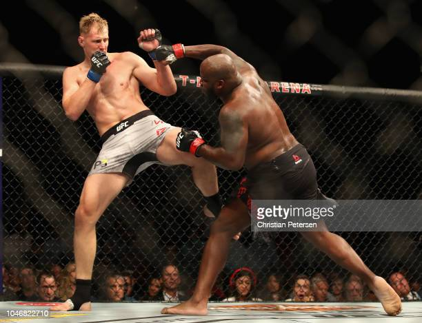 Derrick Lewis punches Alexander Volkov of Russia in their heavyweight bout during the UFC 229 event inside TMobile Arena on October 6 2018 in Las...