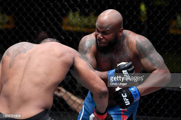 Derrick Lewis punches Curtis Blaydes in a heavyweight bout during the UFC Fight Night event at UFC APEX on February 20, 2021 in Las Vegas, Nevada.