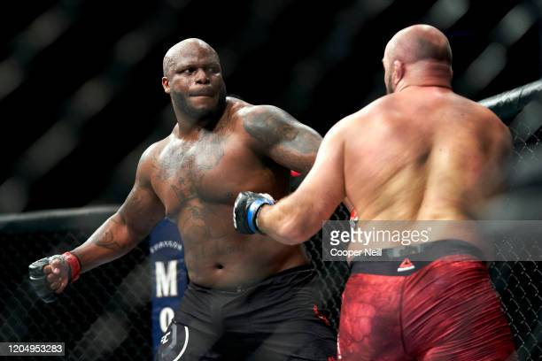 Derrick Lewis punches Ilir Latifi of Sweden during the UFC 247 event at Toyota Center on February 08, 2020 in Houston, Texas.