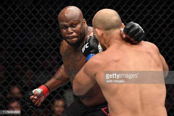 Derrick Lewis punches Junior Dos Santos of Brazil in their heavyweight bout during the UFC Fight Night event at Intrust Bank Arena on March 9 2019 in...