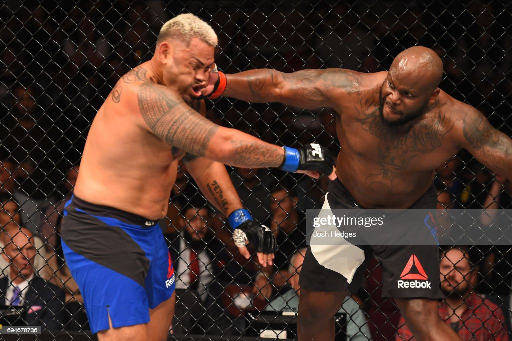 Derrick Lewis punches Mark Hunt of New Zealand in their heavyweight fight during the UFC Fight Night event at the Spark Arena on June 11, 2017 in Auckland, New Zealand.