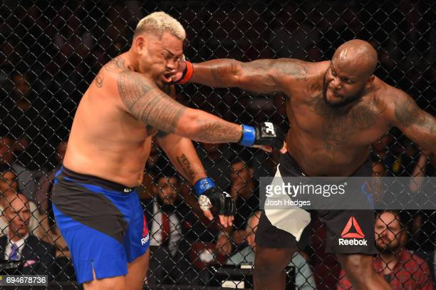 Derrick Lewis punches Mark Hunt of New Zealand in their heavyweight fight during the UFC Fight Night event at the Spark Arena on June 11, 2017 in...