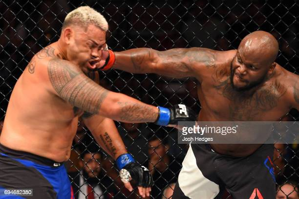 Derrick Lewis punches Mark Hunt of New Zealand in their heavyweight fight during the UFC Fight Night event at the Spark Arena on June 11 2017 in...