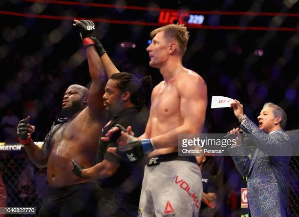 Derrick Lewis raises his arm in victory after knocking out Alexander Volkov of Russia in their heavyweight bout during the UFC 229 event inside...
