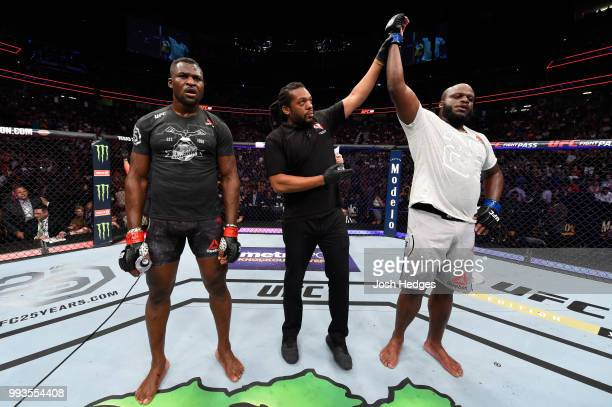 Derrick Lewis raises his hand over Francis Ngannou of Cameroon after their heavyweight fight during the UFC 226 event inside TMobile Arena on July 7...