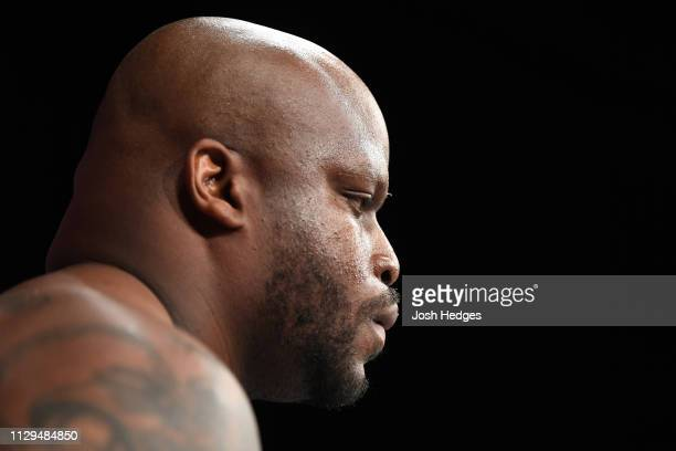 Derrick Lewis stands in his corner prior to facing Junior Dos Santos of Brazil in their heavyweight bout during the UFC Fight Night event at Intrust...