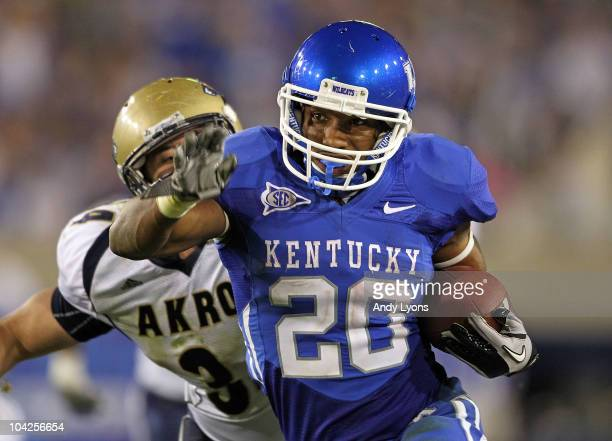 Derrick Locke of the Kentucky Wildcats runs for a touchdown while defended by Brian Wagner of the Akron Zips during the game at Commonwealth Stadium...