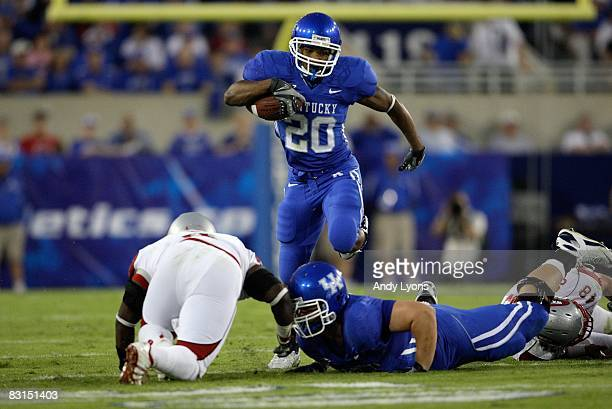 Derrick Locke of the Kentucky Wildcats runs with the ball during the game against the Western Kentucky Hilltoppers at Commonwealth Stadium on...