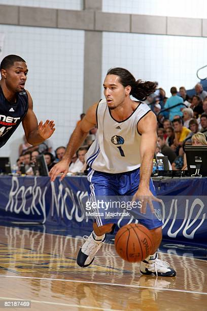 Derrick Low of the Dallas Mavericks makes a move to the basket against Brian Hamilton of the New Jersey Nets during a game at the Rocky Mountain...