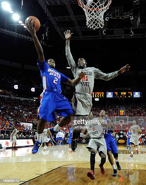 Derrick Marks of the Boise State Broncos puts up a shot against Jamaal Franklin of the Sand Diego State Aztecs during a quarterfinal game of the...