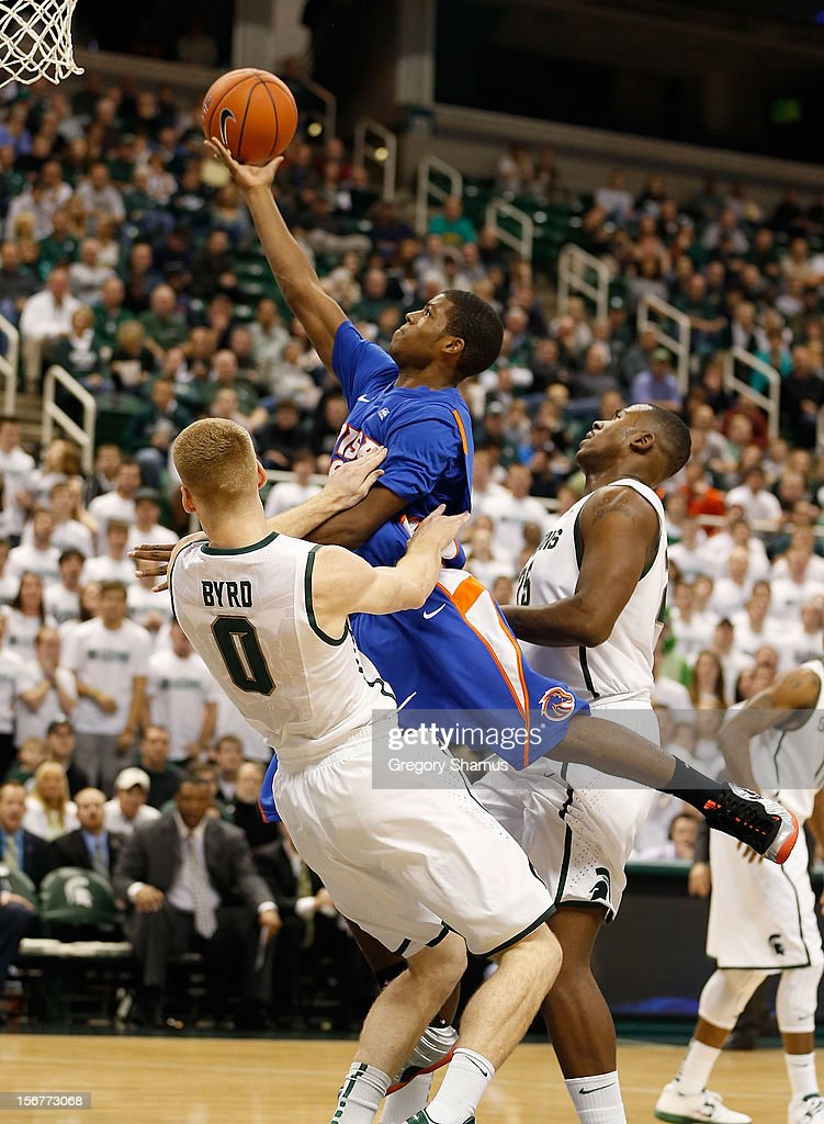 Derrick Marks #2 of the Boise State Broncos tries to get a shot off over Russell Byrd #0 of the Michigan State Spartans at the Breslin Center on November 20, 2012 in East Lansing, Michigan.