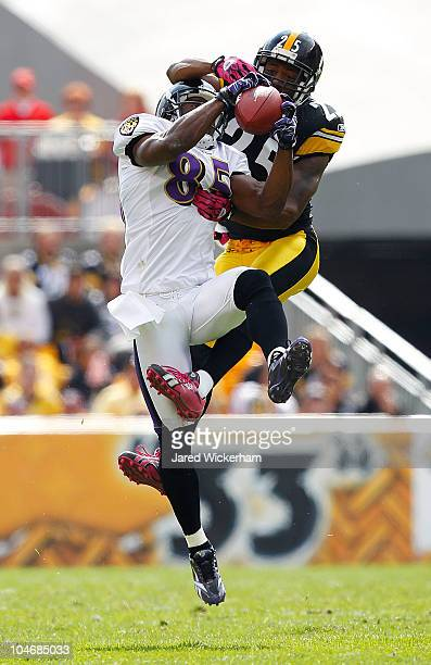 Derrick Mason of the Baltimore Ravens catches a pass in front of Ryan Clark of the Pittsburgh Steelers during the game on October 3 2010 at Heinz...