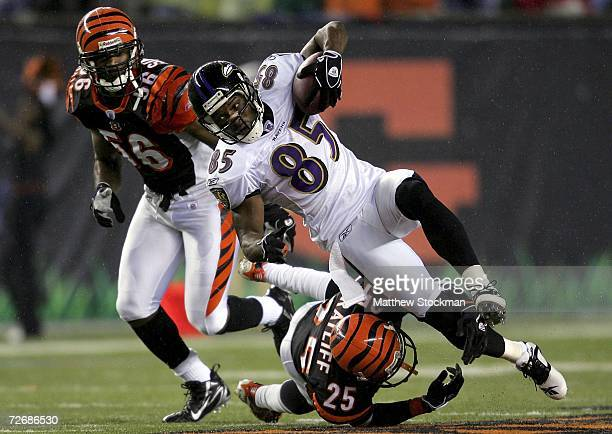 Derrick Mason of the Baltimore Ravens is upended by Brian Simmons and Keiwan Ratliff of the Cincinnati Bengals November 30, 2006 at Paul Brown...