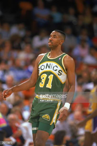 Derrick McKey of the Seattle Supersonics walks on the court in a game against the Los Angeles Lakers during the 19891990 NBA season at the Great...