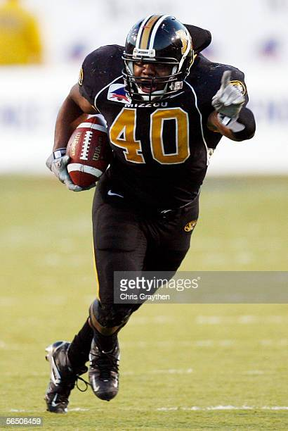 Derrick Ming of Missouri runs back an interception he caught off of his shoe against South Carolina Gamecocks during the Independence Bowl on...