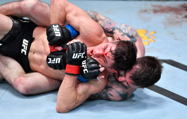 Derrick Minner works for a submission against Charles Rosa in a featherweight bout during the UFC Fight Night event at UFC APEX on February 20, 2021...
