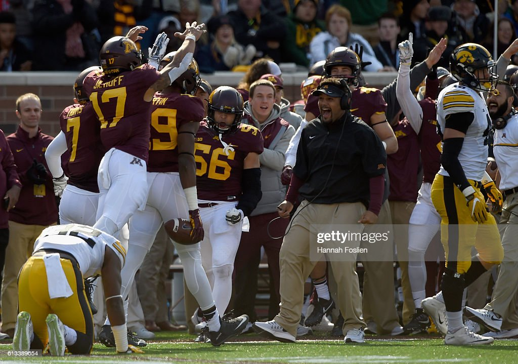 Derrick Mitchell Jr. #32 and George Kittle #46 of Iowa react as Minnesota congratulates teammate Kamal Martin #49 after catching an interception during the fourth quarter of the game on October 8, 2016 at TCF Bank Stadium in Minneapolis, Minnesota. Iowa defeated Minnesota 14-7.