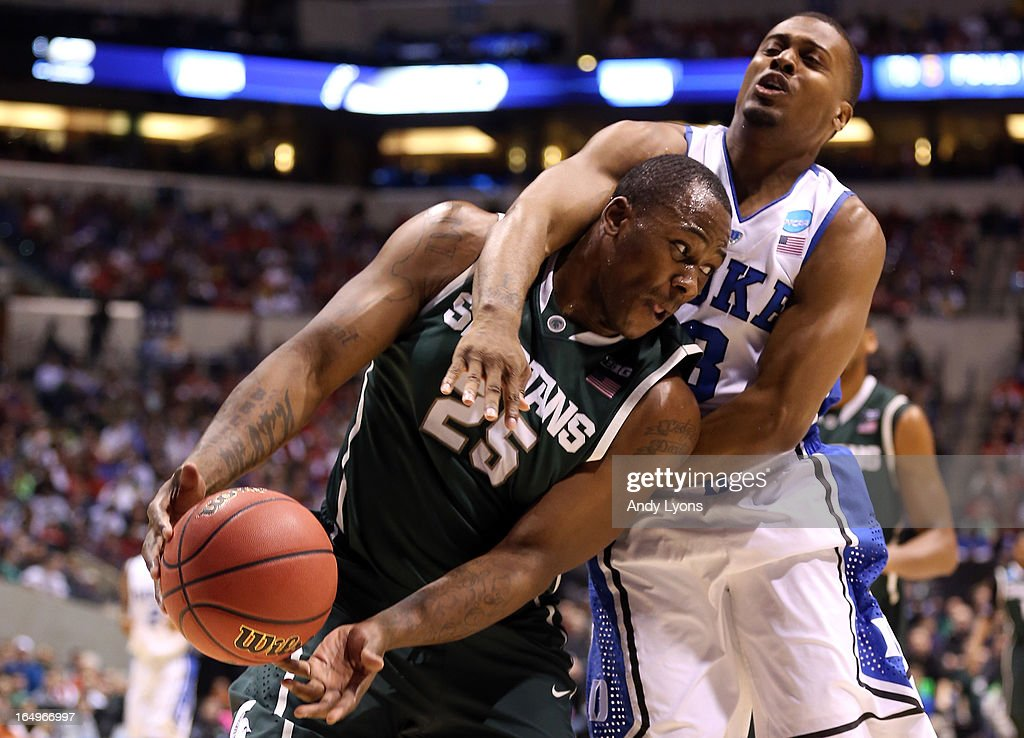 Derrick Nix #25 of the Michigan State Spartans draws contact on offense in the first half against Tyler Thornton #3 of the Duke Blue Devils during the Midwest Region Semifinal round of the 2013 NCAA Men's Basketball Tournament at Lucas Oil Stadium on March 29, 2013 in Indianapolis, Indiana.
