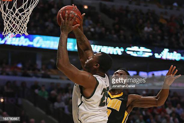 Derrick Nix of the Michigan State Spartans shoots against Gabriel Olaseni of the Iowa Hawkeyes during a quarterfinal game of the Big Ten Basketball...