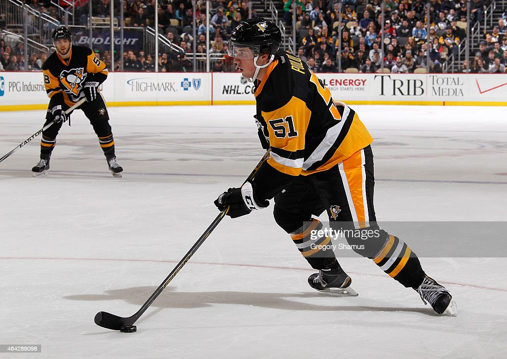 Derrick Pouliot #51 of the Pittsburgh Penguins moves the puck against the Washington Capitals at Consol Energy Center on February 17, 2015 in Pittsburgh, Pennsylvania.