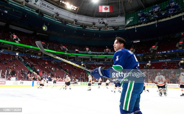 Derrick Pouliot of the Vancouver Canucks juggles a puck during their NHL game against the Philadelphia Flyers at Rogers Arena December 15, 2018 in...