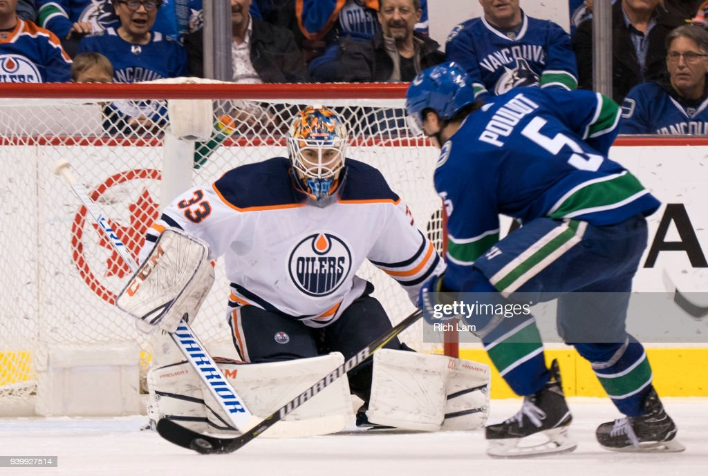 Derrick Pouliot #5 of the Vancouver Canucks makes a move before scorning on goalie Cam Talbot #33 of the Edmonton Oilers in NHL action on March, 29, 2018 at Rogers Arena in Vancouver, British Columbia, Canada.