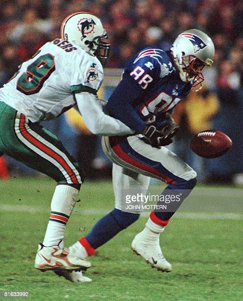 Derrick Rodgers of the Miami Dolphins prevents a reception by Terry Glenn of the New England Patriots in the first half at Foxboro Stadium 23...